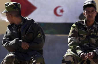 Security men sit in front of a mural of the Western Sahara flag at at the Smara refugee camp in Algeria's Tindouf province, home to some several thousands Sahawari refugees, ahead of the 16th edition of the Sahara Marathon, which is organised to demonstrate solidarity with the Saharawi people and to support the independence of the Western Sahara, on February 22, 2016 . Farouk Batiche / AFP / Getty Images