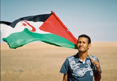 Sahrawi with flag. Credit: Creative Commons